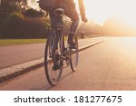 a young woman is cycling into... | Shutterstock . vector #181277675