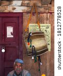 Small photo of Uttarakhand, India - 09 May, 2011: An old drummer with his drum after a hefty performance.