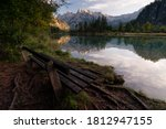 Afternoon sunlight reflections at lake Almsee, huge peaks know as the Dead Mountains with cute bench with a view, Upper Austria, Austria - stock photo
