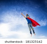 Superhero Kid Flying Against...
