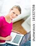 pretty  young woman working on... | Shutterstock . vector #181327058