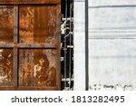 An Old  Rusted Metal Door Next...