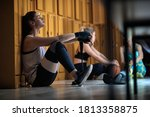Small photo of Female boxer relaxing in a locker room after a strenuous training