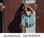 Old Rusty Iron Padlock Hanging...