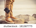 Small photo of Feet man and vintage retro photo camera outdoor Travel Lifestyle vacations concept