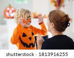 Child and mother in halloween...