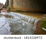 Water Flows Down The Road...