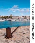 """Small photo of La Rochelle, France. August 7, 2019. View of """"vieux port"""" in La Rochelle. Famous summer destination for French people. In the background the """"Tour de l'Horloge"""""""
