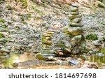 Rock Balancing. Two Piles Of...