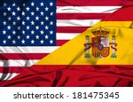 Waving flag of Spain and USA - stock photo