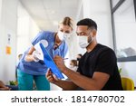 Portrait of nurse and man with...