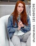 comic woman sit inside of new bathroom, have fun, enjoy, relax. redhead female sit in contemplation, while shopping - stock photo