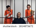 Two Prisoners Plan To Attack A...