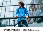 Young Man In Blue Raincoat...