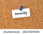 Small photo of Tenacity. Word written on a piece of paper or note, cork board background.