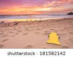 a beautiful beach sunrise at...