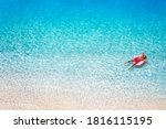 A Man In Swimsuit Floats On A...