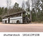 Old Gray Bus Is Abandoned On A...
