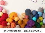balls of wool in various...