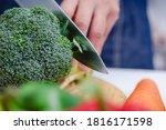 Woman Hands Cutting Broccoli In ...