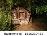 Funny Woodpile House In The...