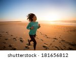 Young Afro Woman Running On The ...