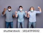 Small photo of Crazy football fan guys support pals watch football world final cup celebrate team victory in corona virus quarantine wear respiratory mask casual clothes isolated gray color background