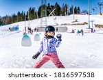 Young Happy Skier Girl Throwing ...