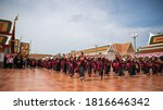 Small photo of Sakon Nakhon,Thailand,September 06,2020:Wat Phra That Choeng Chum,Phutai tribe women Hundreds of lives join together to dance and present Phra That Choeng Chum with a beautiful dance posture.Thailand.