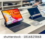 Darmstadt, Germany - September 16th 2020: A German photographer visiting Loop5, the biggest shopping mall in Hesse, taking pictures of the new iPad Pro Pro from Apple in a Saturn market. - stock photo