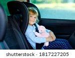 Adorable Toddler Girl Sitting...