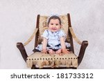 Adorable Baby In The Chair