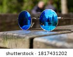 Blue Sunglasses On A Wooden...