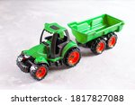 A Green Tractor. Toy For...