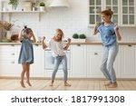 Happy Mother And Kids Dancing...