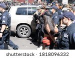 Small photo of NEW YORK, NY - SEPTEMBER 19: NYPD Police officers arrest at least 50 during an Abolish ICE protest at Times Square on September 19, 2020 in New York City.