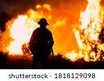Small photo of A firefighter watches as the Bobcat Fire burns in Juniper Hills, California, Saturday, Sept. 19, 2020.