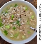 Small photo of Rice soup min pock in white blow close up.