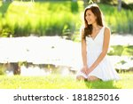 Asian Woman Sitting In Park In...