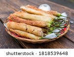 Small photo of Dynamite lumpia or dinamita, a popular Filipino appetizer usually stuffed with cheese or ground beef or pork.