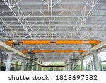 Small photo of Factory overhead girder crane installed under the construction building in the factory