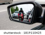 The Side Mirror Of The Car...