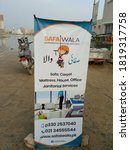 Small photo of A Signboard for a cleaning services namely safai Wala. it is in English and Urdu - Karachi Pakistan - Sep 2020