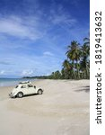 Small photo of Matras Beach, Bangka Island, Indonesia. July 2, 2010. White VW Bug from VW Surabaya Community attended the National Jamboree and take photographed in Matras Beach during summer time