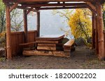 A Gazebo With A Wooden Table...