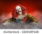 A Scary Clown With A Knife In...