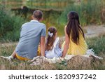 Beautiful Family Sitting By Th...