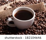 white cup with coffee on burlap ... | Shutterstock . vector #182104646