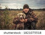 Man Hunter With Hunting Dog...