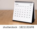 Small photo of Month page: January in 2021 paper calendar on the wooden table